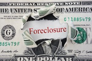 foreclosure text in ripped dollar bill